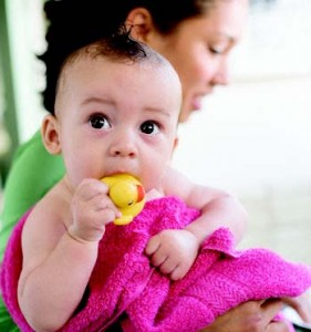 Baby with rubber ducky